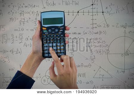 Hands of businesswoman using calculator against mathematical equations with diagrams