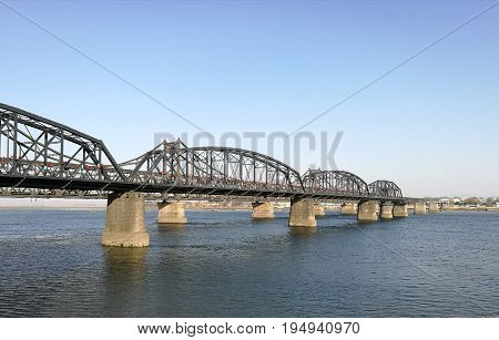 Broken Bridge, Dandong, China (April, 2017) - opposite to Sinuiju city, North Korea; at Yalu river (natural border). It was bombed; repaired only part in China. Taken from public area in China.