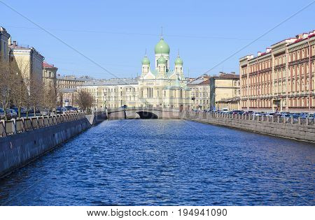 SAINT PETERSBURG RUSSIA - MAY 2 2017: Embankment of Griboedov Canal view of Church of PriestMartyr Isidor Yuryevsky and St. Nicholas the Wonderworker (St. Isidor's Church) St. Petersburg