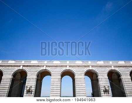 Side view of corridor archway at Palacio Real de Madrid or Royal Palace of Madrid in Spain.
