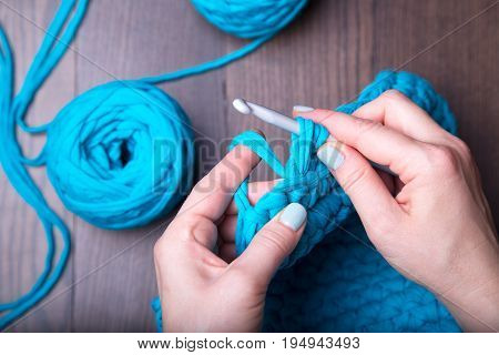 Close-up of hands knitting. Handmade and creative