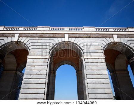 Close-up corridor archway at Palacio Real de Madrid or Royal Palace of Madrid in Spain.