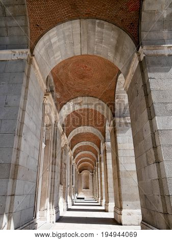 Corridor archway at Palacio Real de Madrid or Royal Palace of Madrid in Spain.