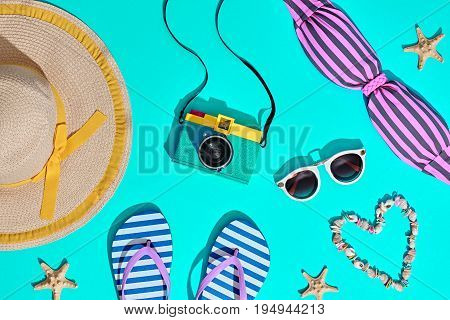 Beach Sunny Set. Fashion Summer Accessories, Film Camera, Stylish Swimsuit Bikini, Trendy Sunglasses, fashion Hat. Hot Vibes. Sweet Bright summer color. Creative Fun Art. Retro Design camera on Blue