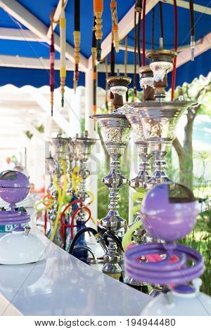 Different Hookahs. Arabic smoke hookah. Cooking and relaxation