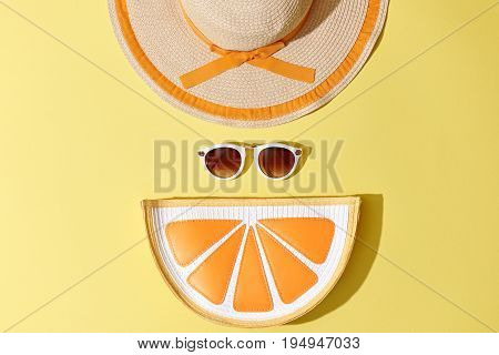 Fashion Sunny Summer Woman Set. Trendy Accessories. Glamor Orange Citrus Clutch, fashion Sunglasses on Yellow. Hot Beach summer Vibes. Creative Bright Style. Vanilla Pastel Color. Minimal, Art