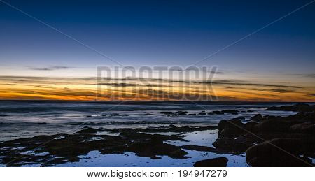 La Jolla tide pools at sunset with views of toned skies