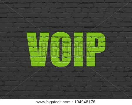 Web development concept: Painted green text VOIP on Black Brick wall background