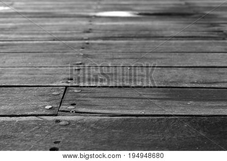 indistinct background and striped texture of old wooden boards of monochrome tone