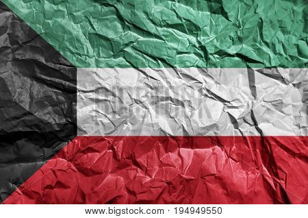 Kuwait flag painted on crumpled paper background