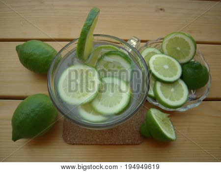 Lime water on a wooden table, Invigorating drink.