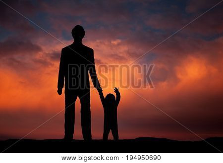 Father and little boy watching the sunset