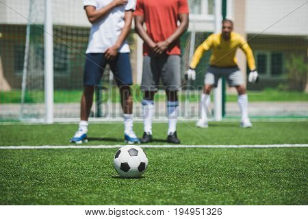 Group Of Soccer Players During Soccer Match On Pitch, Focus On Foreground