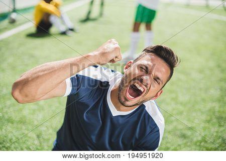 Portrait Of Happy Soccer Player Celebrating Goal During Soccer Match
