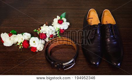Black Leather Shoes, Belt And Boutonniere Lie On The Floor