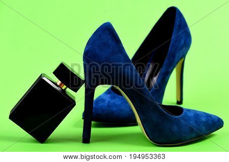High Heel Footwear Isolated On Green Background. Fashion And Scent