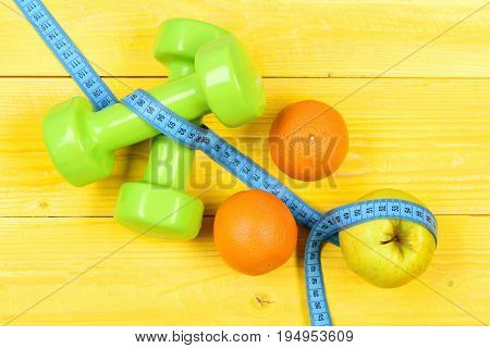 Dieting Concept, Dumbbells Weight With Measuring Tape, Fruit