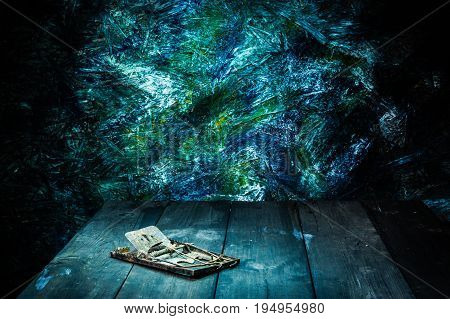 Still life style of old rattrap on wooden floor with colorfull backgroud