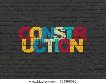 Building construction concept: Painted multicolor text Construction on Black Brick wall background