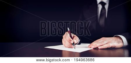 Businessman Writing A Legal Letter In His Dark Office