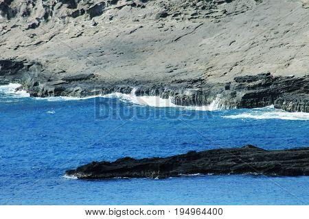 Rocky Outcrop in Hawaiian Blue Waters, Honolulu, Hawaii