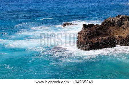 Landscape image of a Rocky Outcrop in Hawaiian Blue Waters