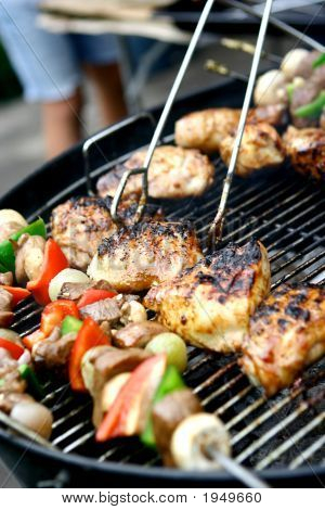 Hot Sizzling Meat And Vegetables On Barbecue Grill