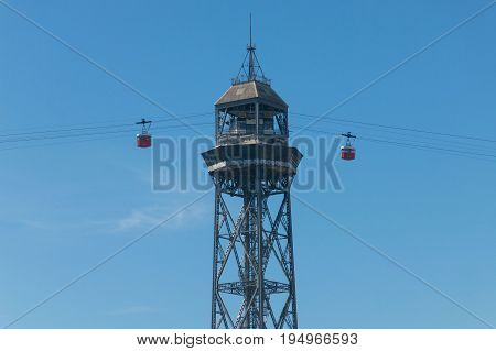 Car of the Aerial Tramway arriving at San Sebastian Tower at the end of the Ramblas. The Port Vell Aerial Tramway is an aerial tramway in Barcelona Catalonia Spain