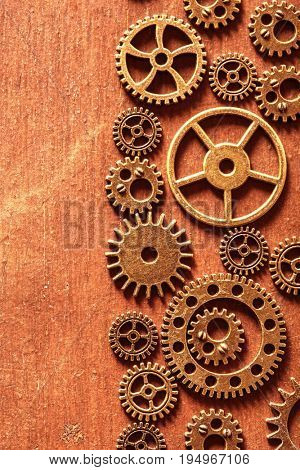 steampunk mechanical cogs gears wheels on wooden background