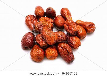 Dried red jujube on white background.Herbal fruit and good for health; using in traditional Chinese medicine.