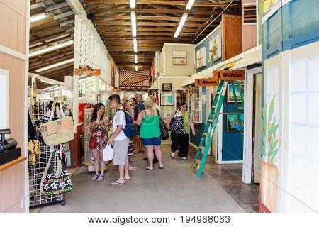 Honolulu, Hawaii, USA - May 29, 2016: Tourists visit the Tropical Farms Macadamia Nut Outlet on the windward coast of Oahu.