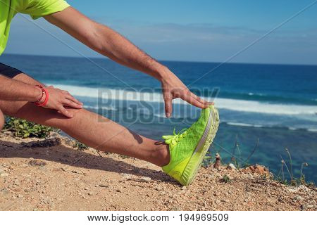 Stretching after jogging / exercise on the sea / ocean shore.