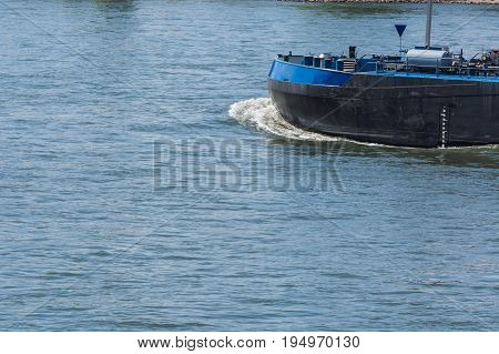 Bug of a large merchant ship container ship on a large river.