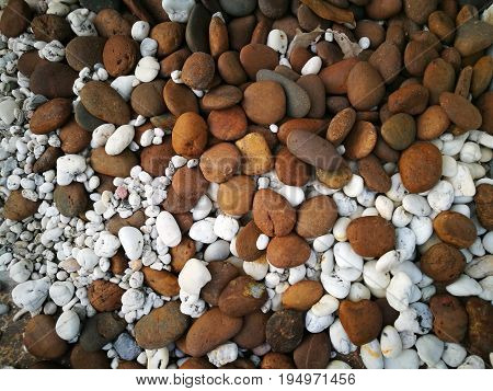 Mixed brown and white small stones texture; useful for background