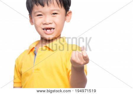 Little Asian Boy Showing His Lost Milk-tooth In His Hand - Closeup