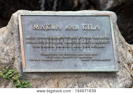 Honolulu Hawaii USA - May 28 2016:Makua and Kila plaque for the bronze sculpture along Waikiki Beach.
