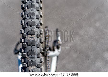 Outworn bicycle tire close up on grunge background