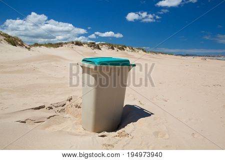 The rubbish bin on the sand beach on the peninsula in Santander Spain.