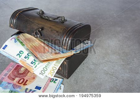 Euro banknotes stuffed in the vintage chest