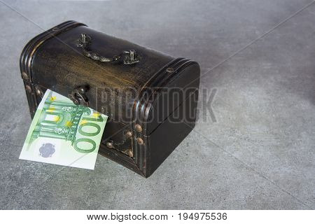 The half of hundred euro inserted in the chest box