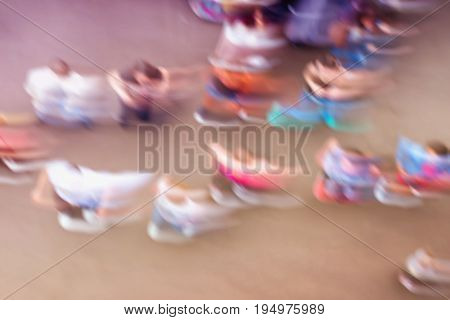 Abstract bright blurred background with dancing unidentified people on outdoor area. Top view, colour trend. Concept of active healthy lifestyle, sport, leisure. For backdrop, substrate