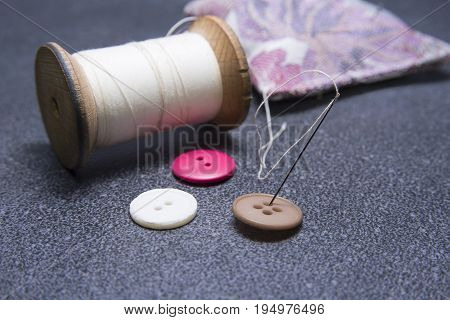 Needle in the button with old thread