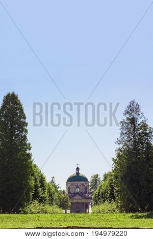 Old church of Exaltation 18th century near Pidhirtsi Castle between trees, Ukraine