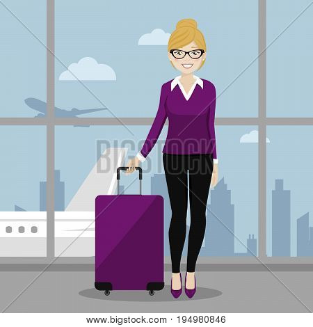 Executive female walking with her suitcase at the airport