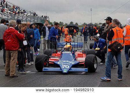 MAGNY-COURS FRANCE July 1 2017 : Crowd on the grid. The First French Historic Grand Prix takes place in Magny-Cours with a lot of ancient sports and Formula one cars.