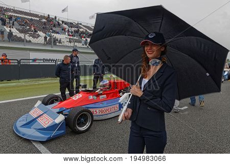 MAGNY-COURS FRANCE July 2 2017 : Smile umbrella and Formula One. The First French Historic Grand Prix takes place in Magny-Cours with a lot of ancient sports and Formula one cars.