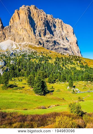 The concept of extreme and ecological tourism. Windy autumn day. Travel to South Tirol. The famous Sella Pass in the Dolomites