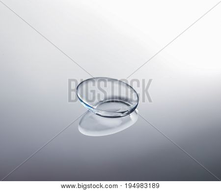 Contact lens on gray background