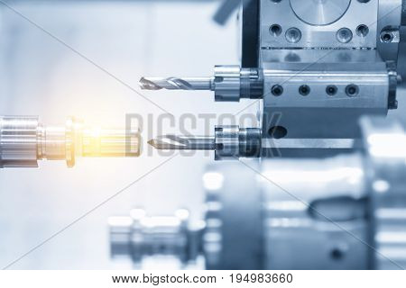 CNC lathe machine or Turning machine drilling the copper rod .Hi technology manufacturing