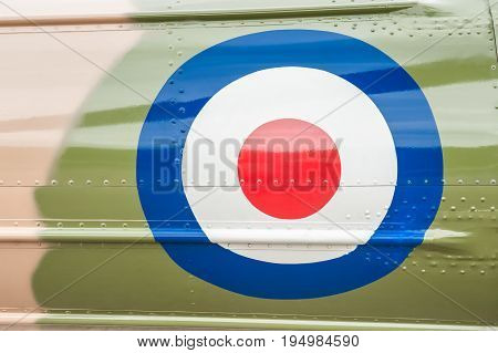 British military roundel on a camouflaged vintage aircraft
